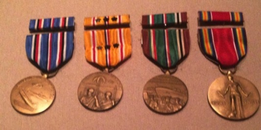 These four WWII medals were donated by three organizations. Mr. Tom earned them all